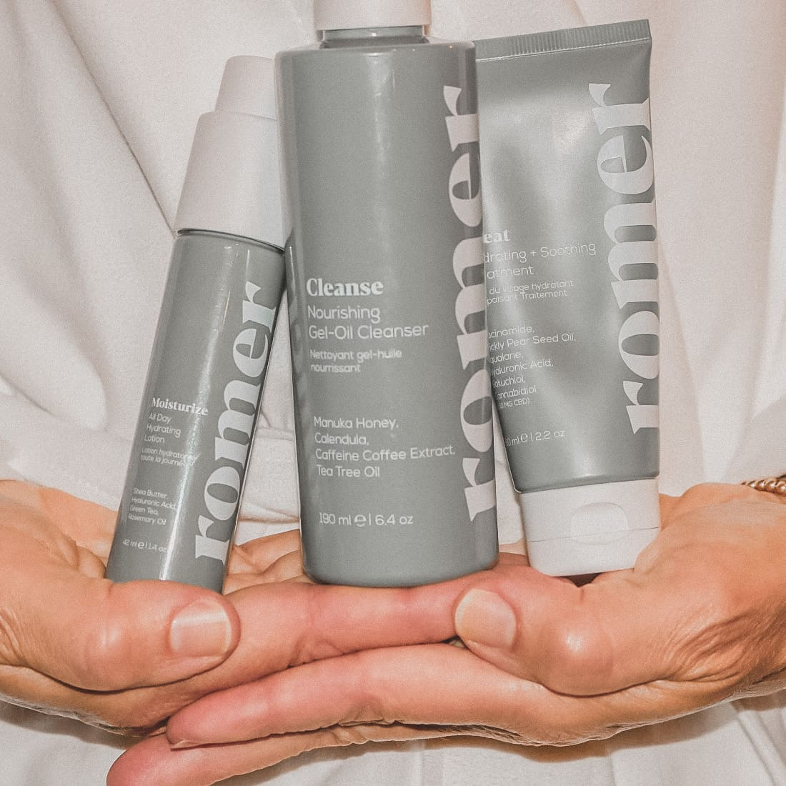 romer skincare three step regimen held in women's hands wearing a spa robe