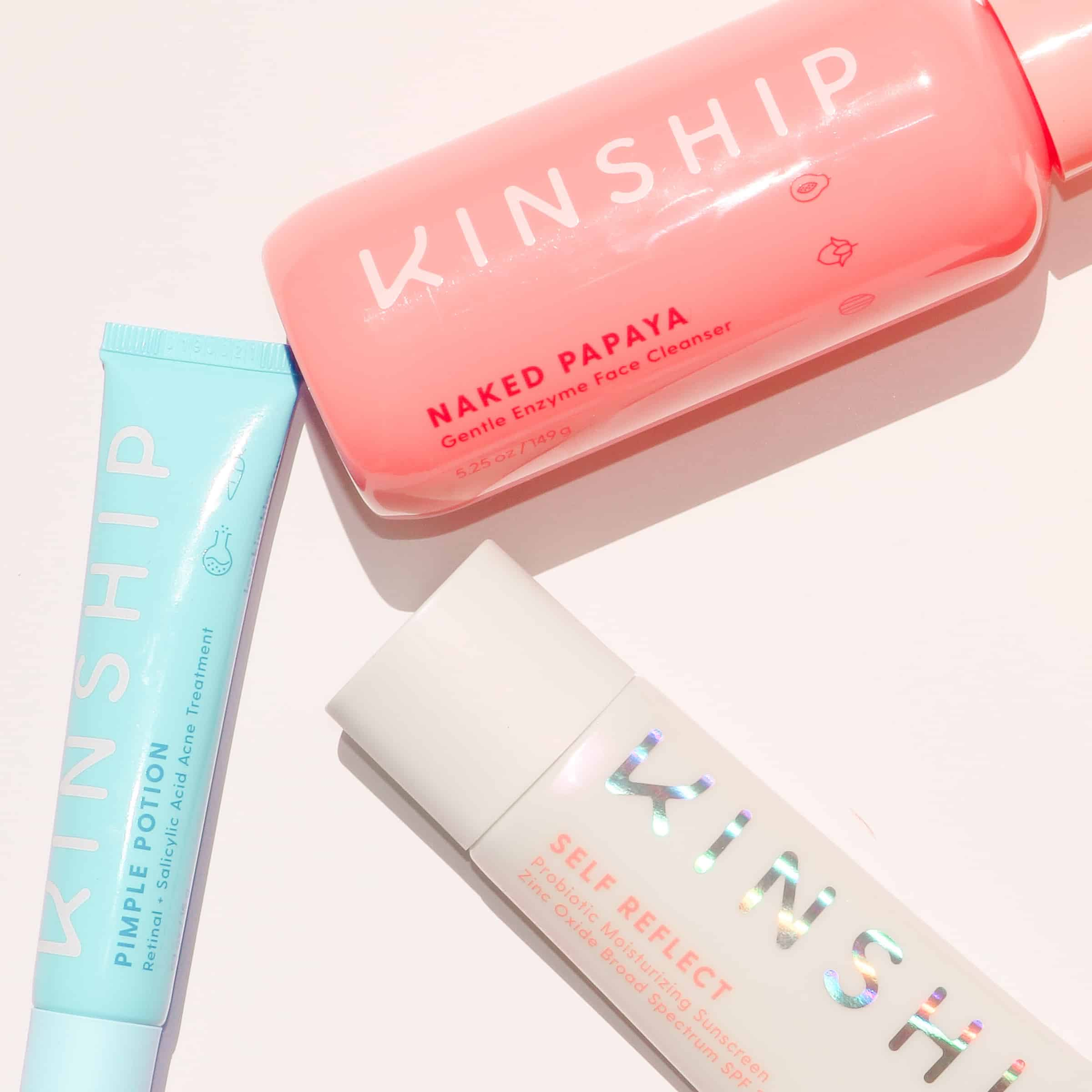love kinship flatlay with their papaya enzyme cleanser, zit treatment and self reflect spf 32