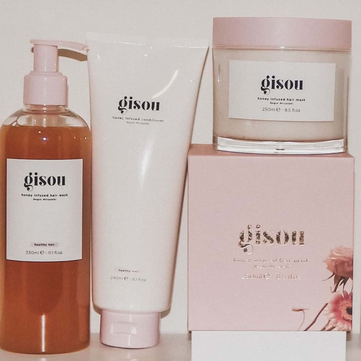 gisou haircare review photo featuring shampoo conditioner and honey hair mask