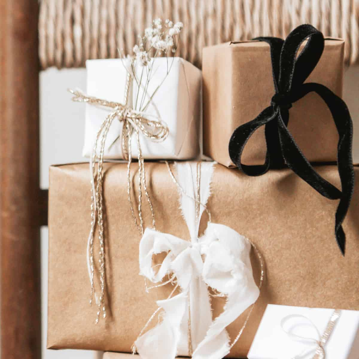 stacked presents wrapped in neutral colored wrapping paper